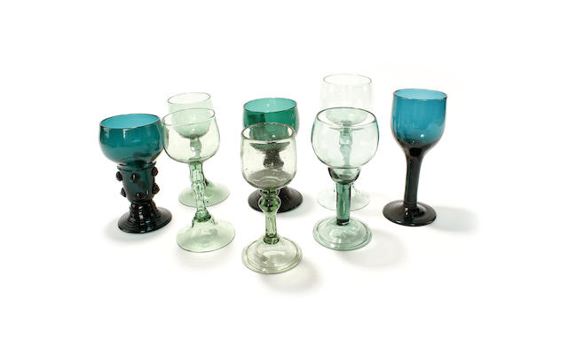 Five pale green export glasses and three other green glasses, 18th century and later