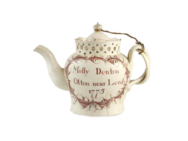 A creamware teapot and cover, dated 1775