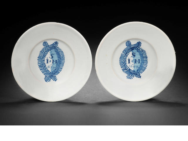 A pair of London delftware plates, dated 1678