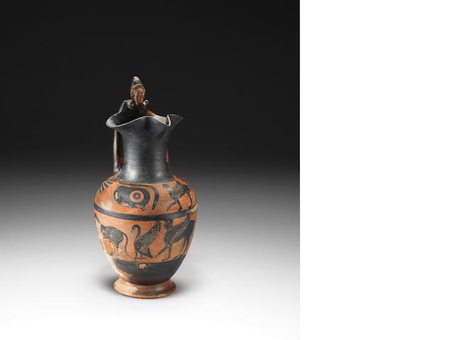 An Etruscan black figure oinochoe Etruscan jug, 6th century B.C.