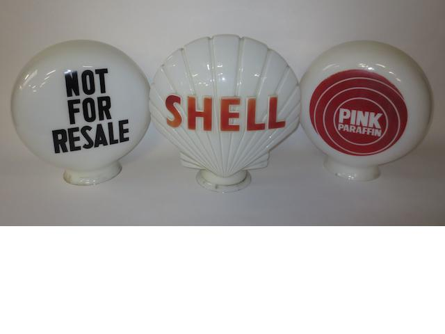 Three glass petrol pump globes,