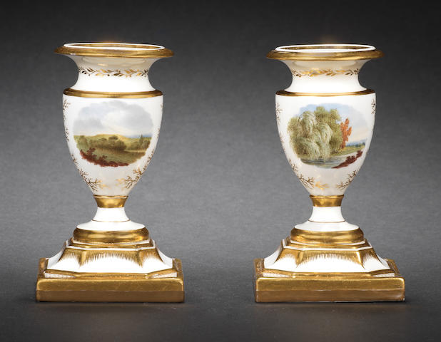 A good pair of Flight, Barr and Barr table candlesticks, circa 1825