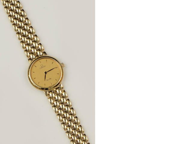 Omega: An 18ct gold lady's De Ville quartz wristwatch