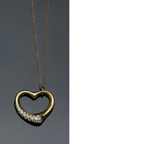 Tiffany & Co: An 18ct gold diamond set heart pendant