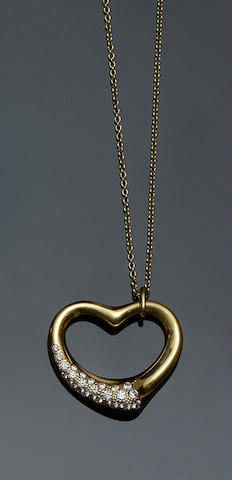 Tiffany & Co: An 18ct gold diamond set heart pendant