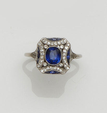 An Art Deco sapphire and diamond panel ring