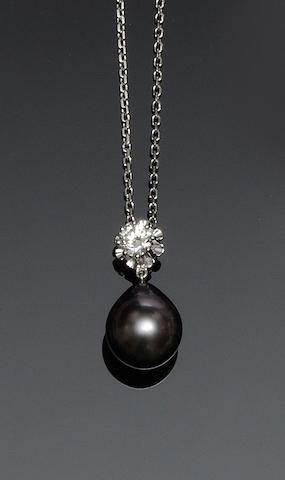 A cultured pearl and diamond pendant necklace