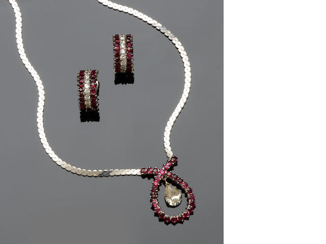 An 18ct white gold diamond, white stone and ruby necklace and earrings (2)