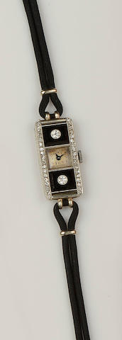 An Art Deco diamond and onyx cocktail watch