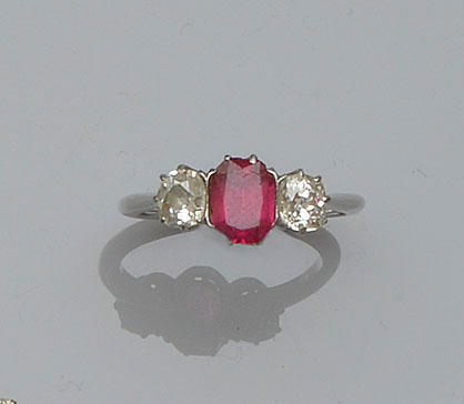 A spinel and diamond three stone ring