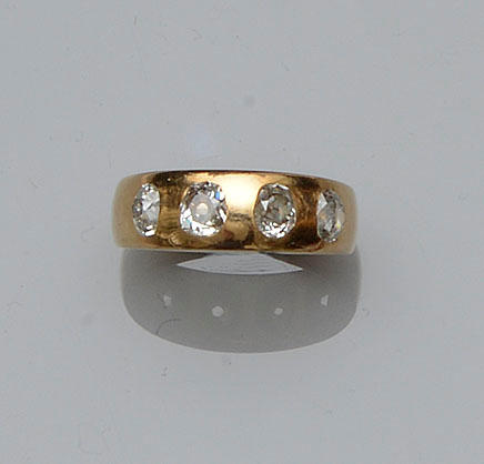A diamond four stone band ring