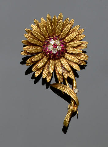 An 18ct gold ruby and diamond flower brooch