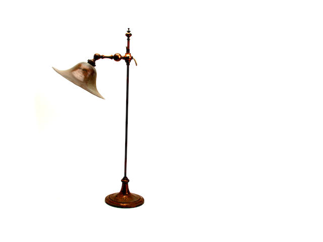 An early 20th century adjustable copper electric table lamp