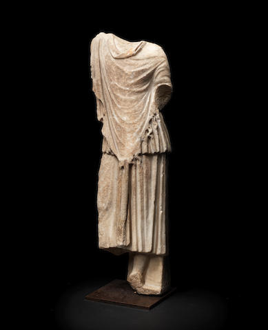 A Roman marble draped figure of a young man