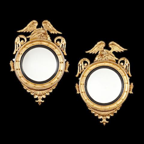 A near pair of 19th century giltwood convex mirrors