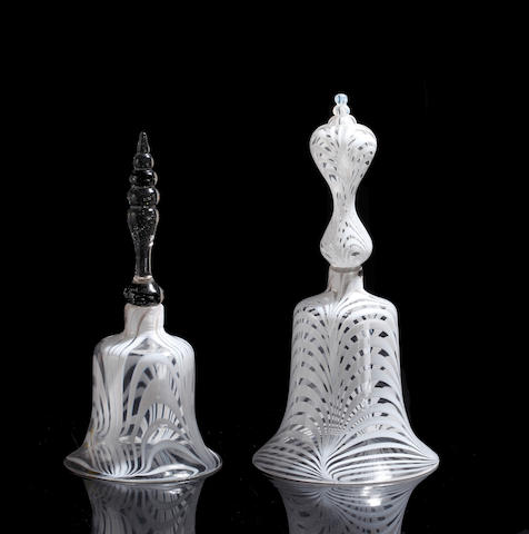 Two late 19th Century glass white swirl bells