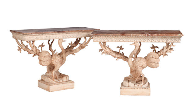 A pair of 18th Century style carved and white painted pine console tables