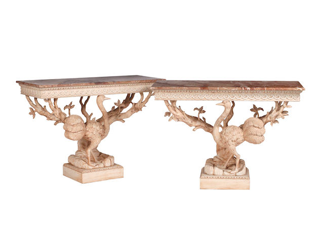 A pair of carved and white painted pine console tablesIn the 18th Century manner