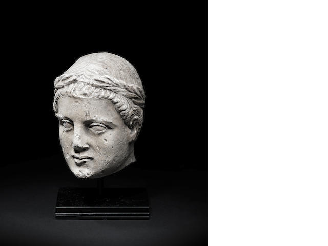 A Cypriot limestone votive head of a youth