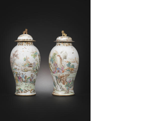 A pair of famille rose vases and covers Qianlong