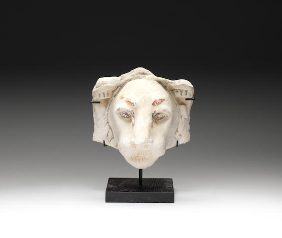 An Egyptian stucco lion mask