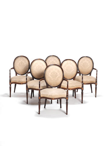 A set of six late 19th century mahogany and satinwood marquetry open armchairs by Wright and Mansfield in the Sheraton style