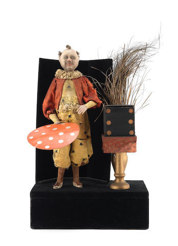 A clown magician musical illusion automaton,  French,  circa 1880,
