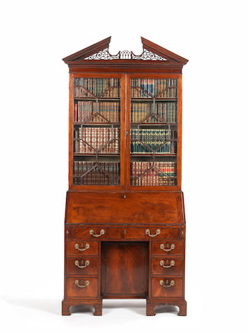 A George III mahogany bureau cabinet with pierced fretwork pediment