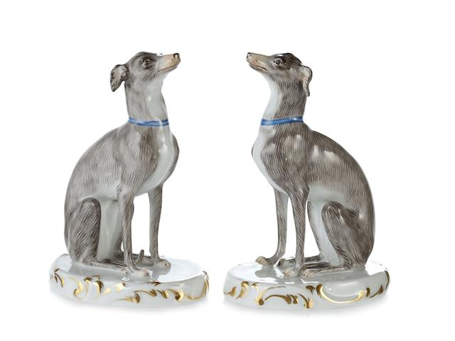 Two Meissen models of seated greyhounds