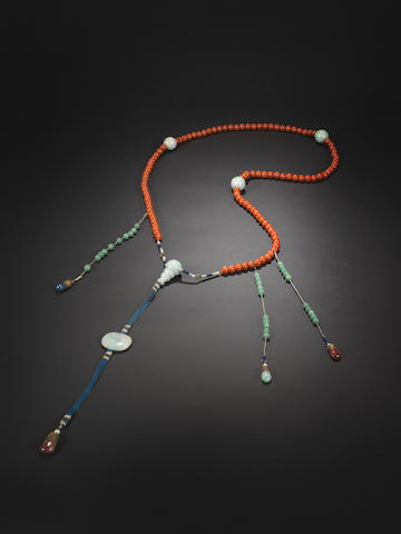A mandarin coral and jade necklace, 19th century