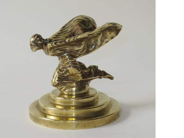 A late pre-War or early post-War Rolls-Royce kneeling Spirit of Ecstasy mascot,