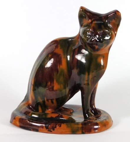 A Staffordshire or Yorkshire pottery model of a cat 19th century