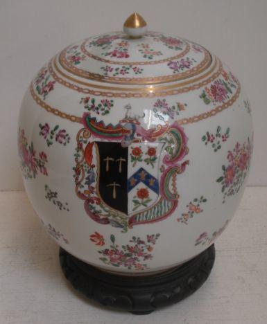 A Samson baluster jar and cover, painted in the 'famille rose' palette and centred by a crest and armorial, heightened with gilding, 23cm, carved ebonsied stand.