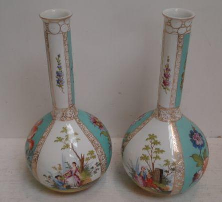 A pair of Dresden porcelain bottle vases, painted with alternating panels of courting couples in landscapes and bouquets of flowers on a blue ground, heightened with gilding, marked 'Dresden' in blue, 33cm.