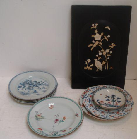 Two Chinese 'famille rose' plates, Qianlong, painted with birds and flowers, four similar period blue and white plates, four others decorated in blue and iron red and a Japanese rectangular black lacquer panel, decorated with a quail and flowering branches in carved bone.