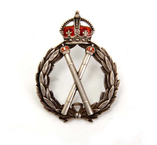 A silver police commissioner cap badge