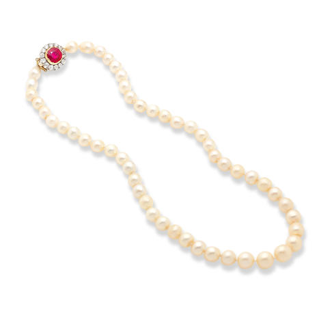 A single-row natural pearl necklace with ruby and diamond clasp