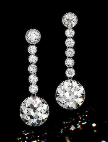 A pair of diamond pendent earrings