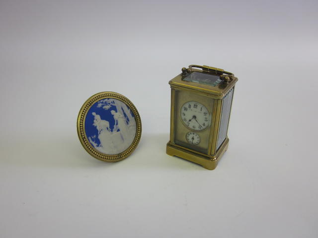A late-19th century gilt-metal mounted blue and white jasperware panel apparently unmarked  (2)