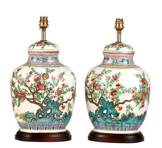 A pair of Chinese famille rose baluster vases and covers