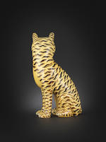 A yellow and aubergine-glazed seated cat   19th century