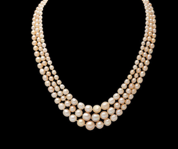 A pearl necklace with a diamond clasp