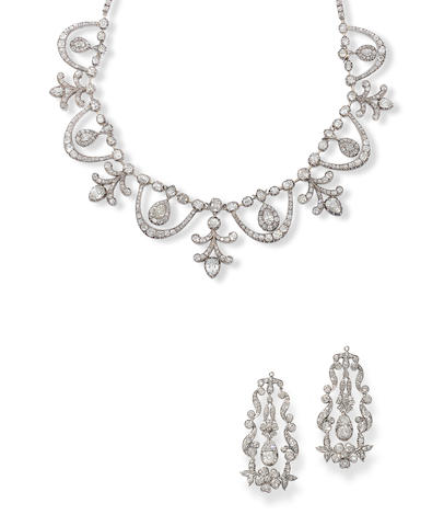 A diamond necklace and pair of earrings, (2)