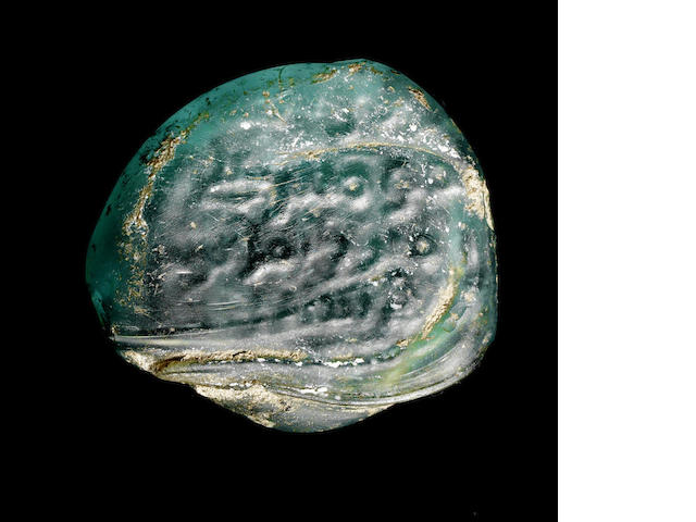 An Umayyad glass vessel Stamp, dated AH 129/AD 746, in the names of Caliph Marwan II (AH 127-132/AD 744-750) and Zamil b. 'Amr (Finance Director of the Oasis of Damascus) Syria