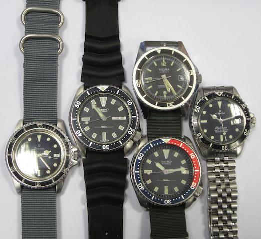 A lot of five calendar dive watches