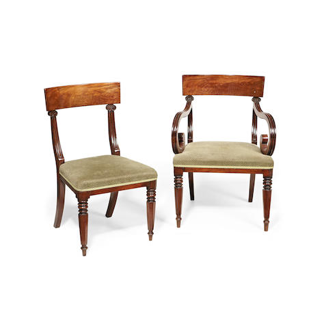 A set of fourteen early 19th century mahogany dining chairs