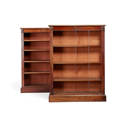 A near pair of late Victorian mahogany open bookcases  by E. and J. Jones