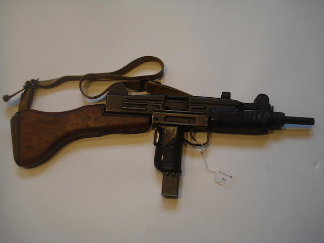 A deactivated 9mmP 'Uzi' sub-machine gun by IMI, no. 1930251/0211643