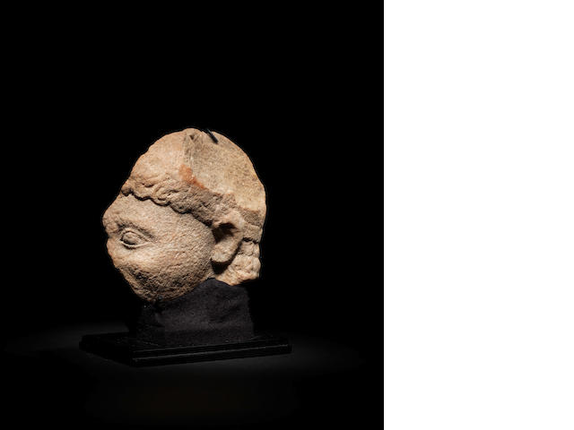A Greek quartzite head fragment
