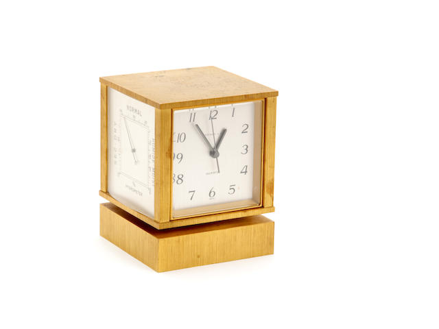 A brushed Brass rotating desk clock Inscribed Tiffany & Co